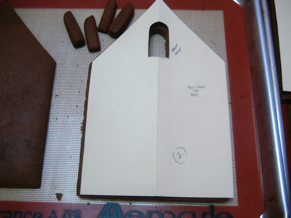 The template for the front and back of the house, cut out of a file folder.